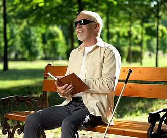 Blind man sitting on a bench.