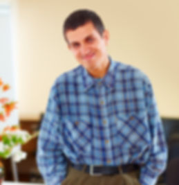 Man with a disability smiling with hands in pockets