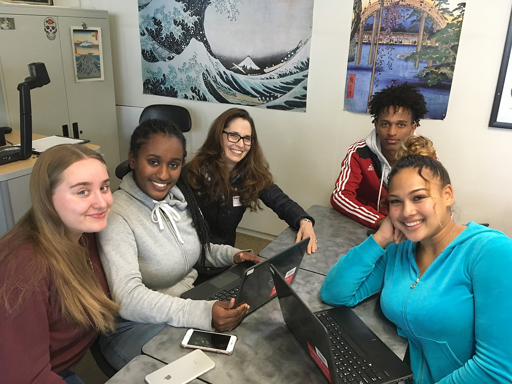 Sonja volunteering with current CAN students at Nathan Hale High School