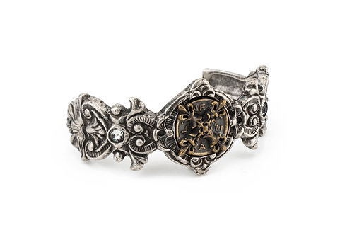 MIXED METAL FIEURI CUFF WITH X MEDALLION