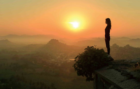 woman-overlooking-sunrise-mountains.jpg
