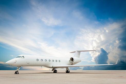 jet plane parked with nice cloud .jpg