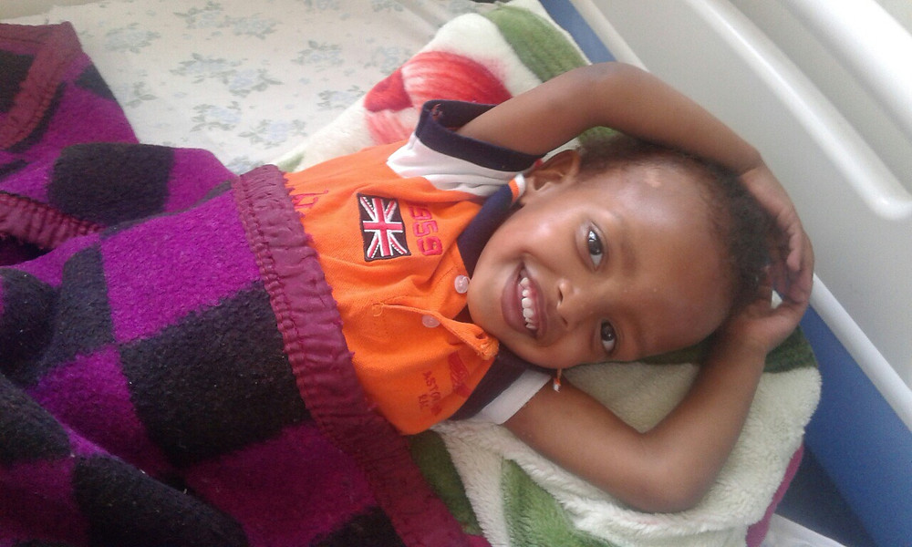 Ebenezer, all smiles, making a full recovery after a successful operation