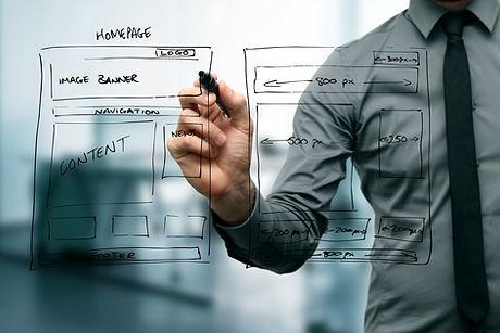 Designer Drawing Website Development Wireframe.jpg