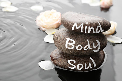 Spa stones with words Mind, Body, Soul a
