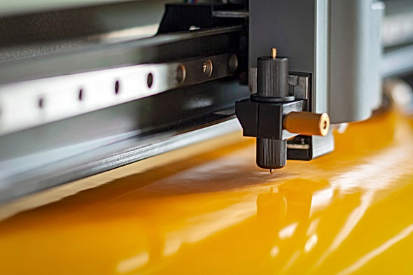 Cutting plotter close-up. The process of
