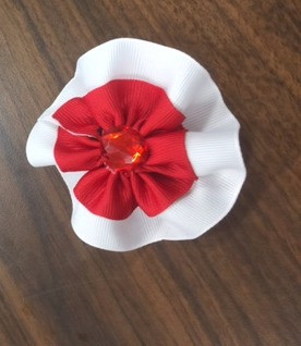 Red and white flower petal bow with red jewel center mightylinksfo