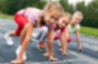 photo of kids racing