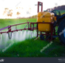 stock-photo-tractor-spraying-wheat-field