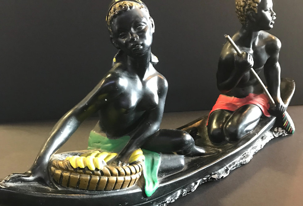 Vintage Black lady padding a canoe
