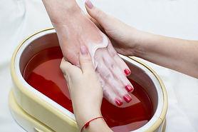Process paraffin treatment of female hands in beauty salon.jpg