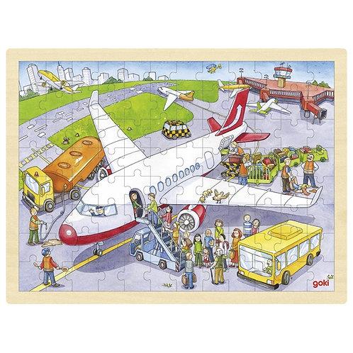 Goki Puzzle, At The Airport