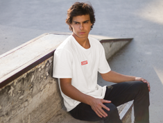 young-man-sitting-on-a-concrete-bench-t-