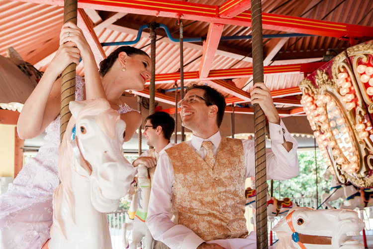 Newlyweds on carousel