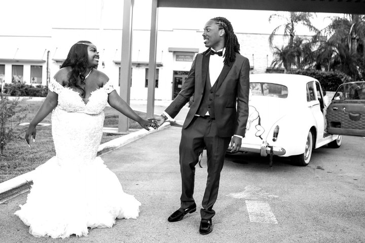 Newlyweds with classic cars