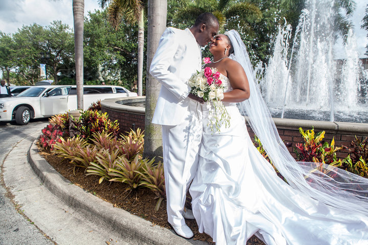 Newlyweds by water fountain