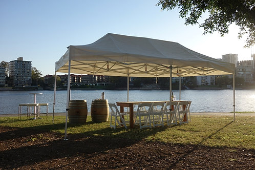 3 meter by 6 meter marquee with wine barrels, rustic timber tables and white americana chairs.