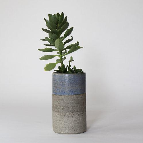 Cylinder vase with blue top