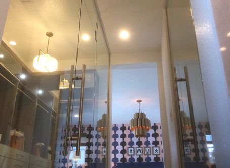 Reimagining Closet Space: Installing custom glass closet entry walls in your home or bathroom.