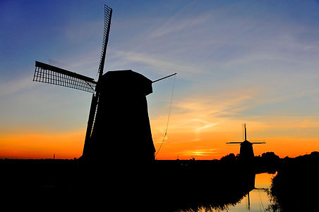 Windmills at sunset in Schermer Polder the Netherlands