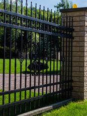 A modern metal fence around the house.j