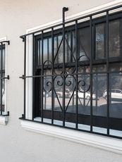 windows with grill steel.jpg