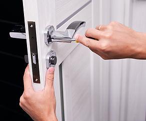 handyman repair the door lock in the roo