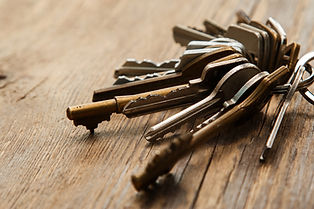 Bunch of different keys on wooden surfac