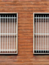 Window bars and closed windows on a bric