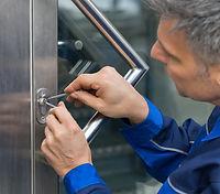 Mature Male Lockpicker Fixing Door Handl