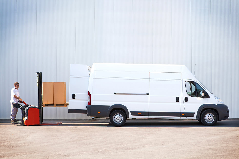 Courier is loading the van with parcels.jpg