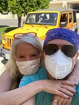 Erbil Gunasti Daphne Barak w masks.jpg