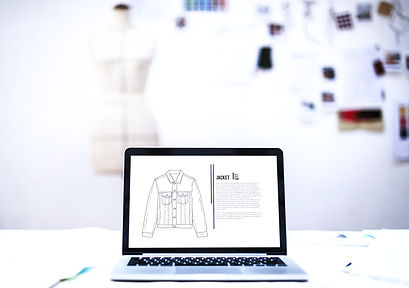 Laptop%20with%20Fashion%20Sketch_edited.