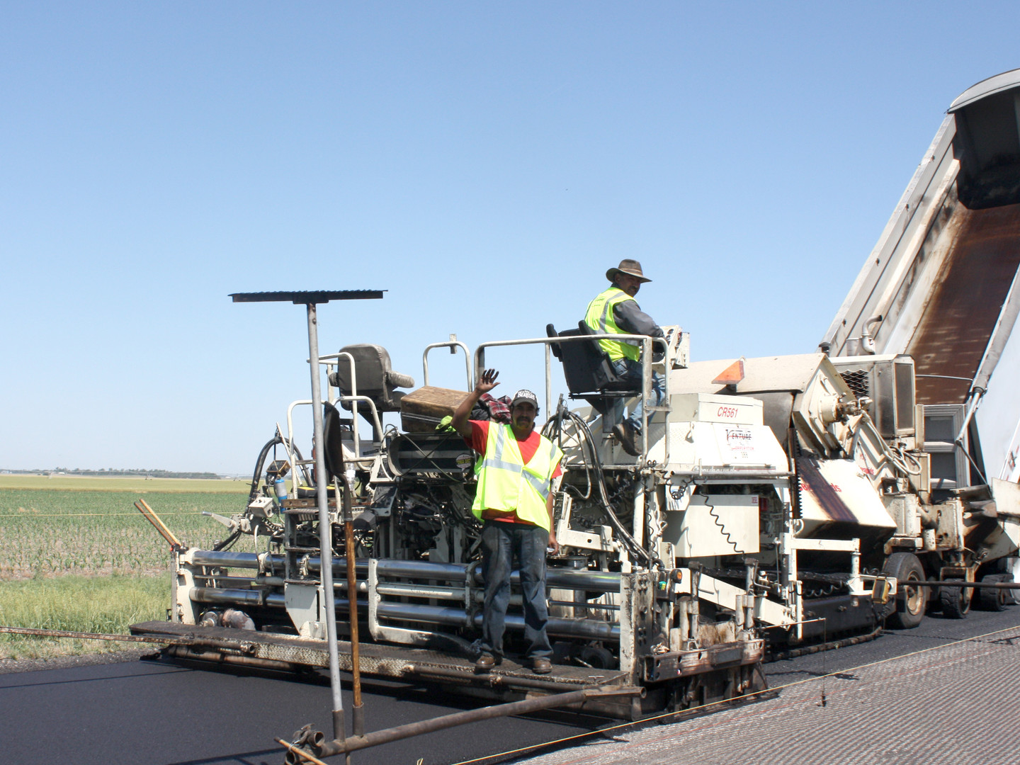 Highway Paving Employee Waving.jpg