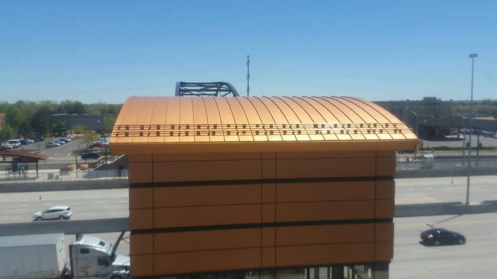 Curved metal tiley roofing overpass
