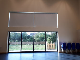 Roller blinds in a Community hall in Swindon