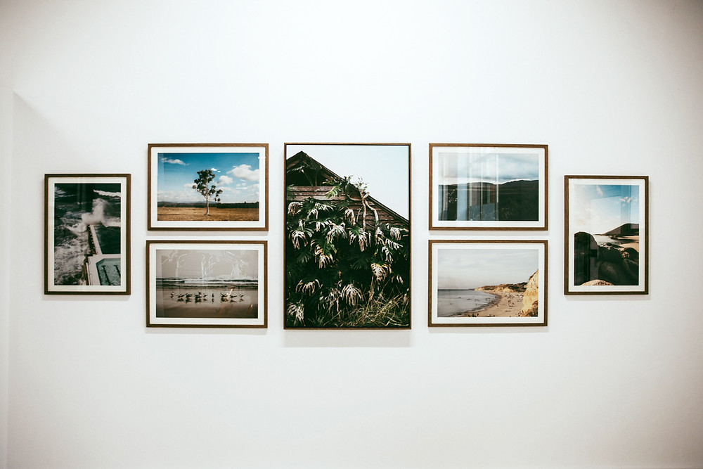 Landscape images hung on the gallery wall.