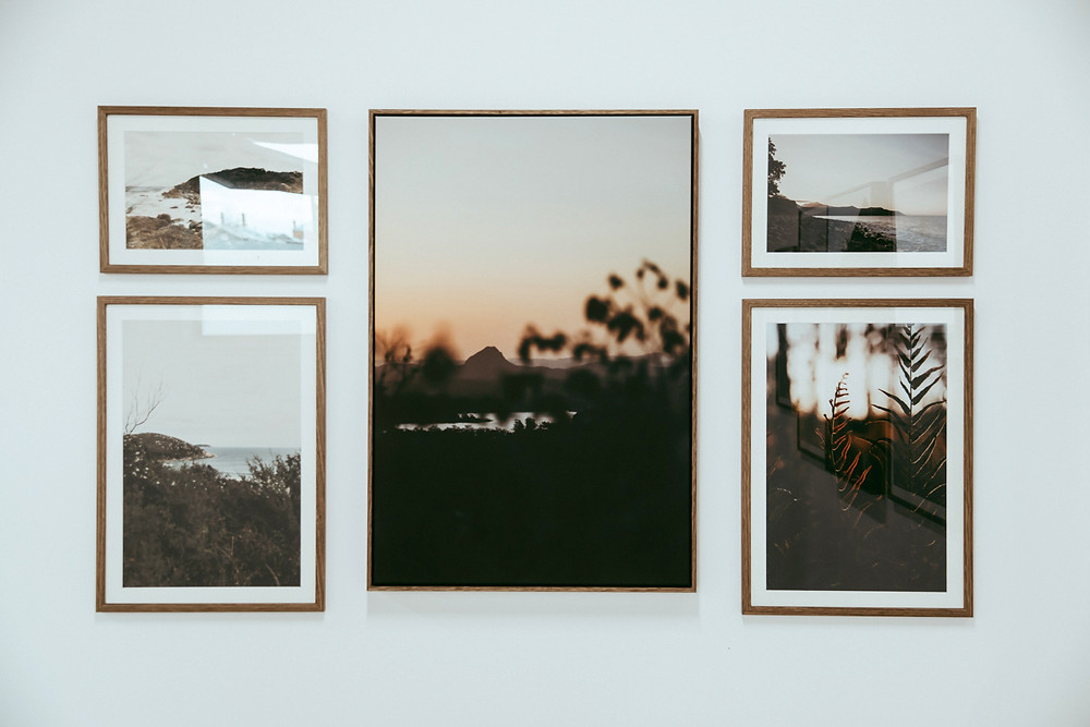 5 landscape images hanging in the exhibition