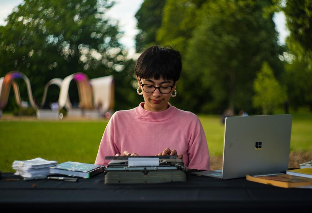 Me at my desk in Kew typing away at my typewriter
