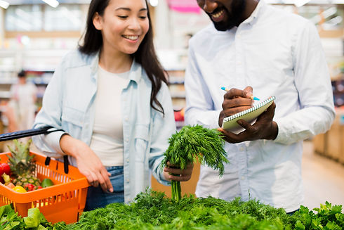 happy-couple-choosing-greenery-grocery-store.jpg