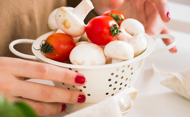 oss-woman-preparing-food-mushroom-tomato