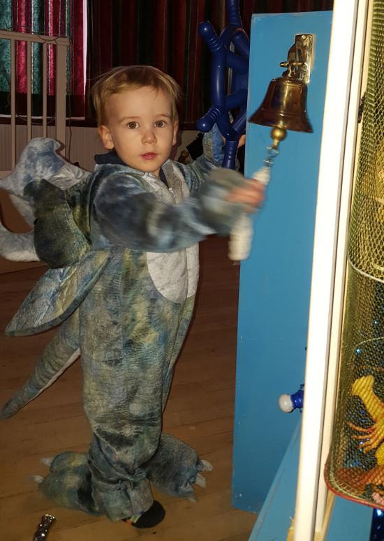 Dinosaur ringing a ship's bell