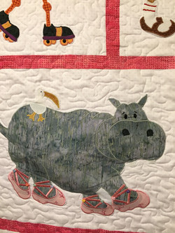 Close up of zoo animals with their buttons on their toes Tracey K quilt.jpg