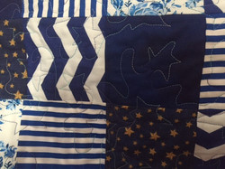 Flag Quilt by Esther G closeup of star Meander over the blue area where stars go on this quilt.jpg