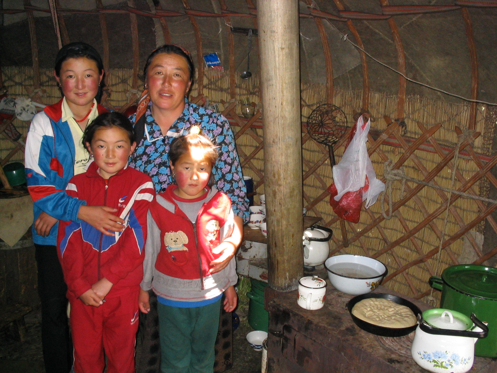 1 Kyryz women in kitchen section of yurt