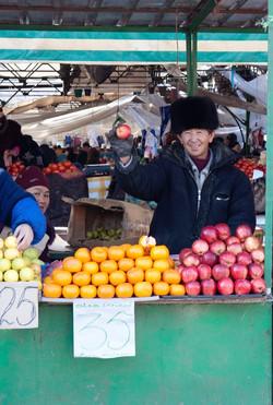 4 Kyrgyz fruit-sellers in winter