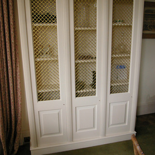 A period-correct display cabinet from the same house