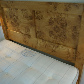 This double bed featured an ornate oak headboard