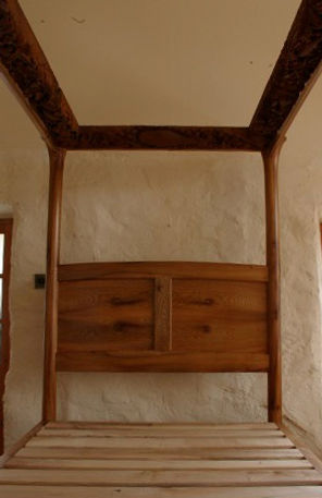 Oak four-poster bed with decorative loveheart inbuilt drawers