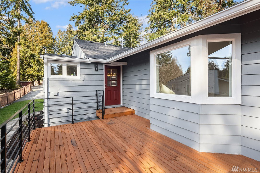 Huge, gorgeous deck off of dining room with access to the gorgeous backyard - perfect for fun and entertaining.